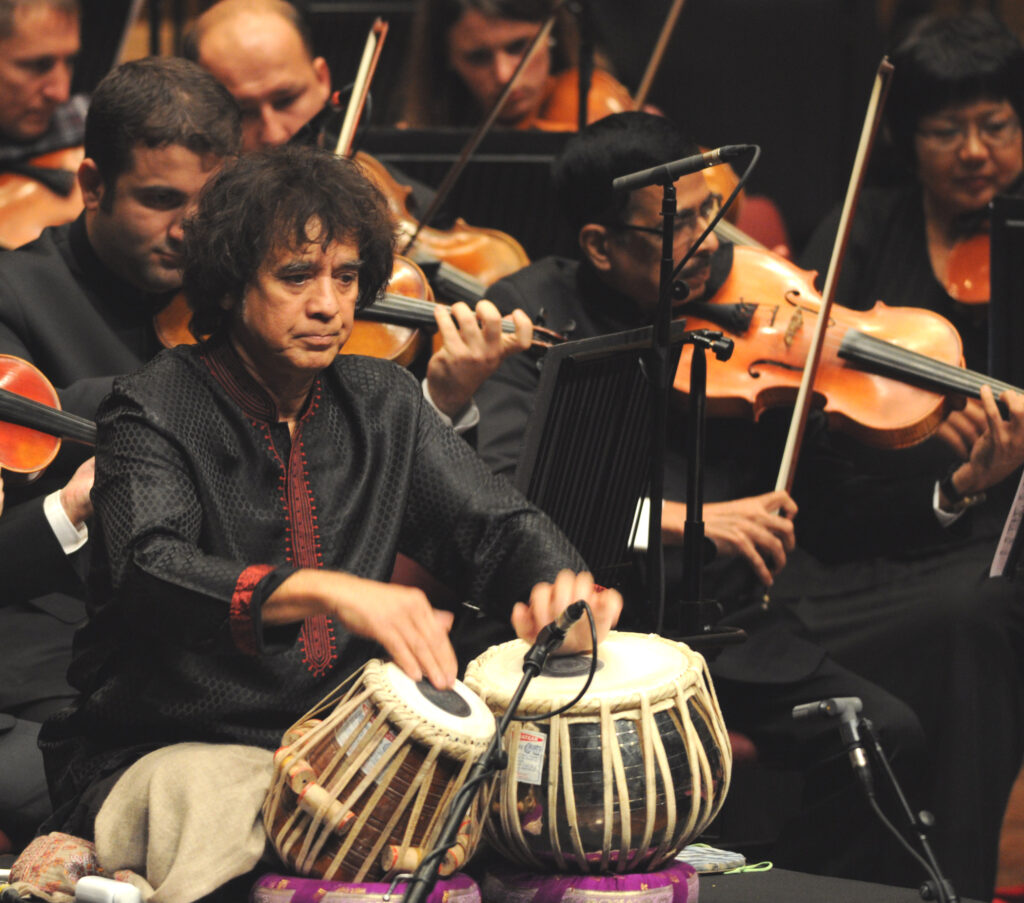 Ustad Zakir Hussain performing his composition Peshkar with the Symphony Orchestra of India at the NCPA in Mumbai, in 2015