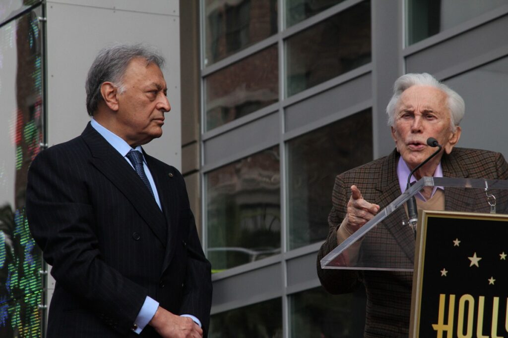 Zubin Mehta and actor Kirk Douglas (speaking) at the unveiling of the Zubin Mehta Star on the Hollywood Walk of Fame, in 2011
